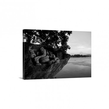 A carving Of Ganesha On A Rock Jutting Into The Brahmaputra River Wall Art - Canvas - Gallery Wrap