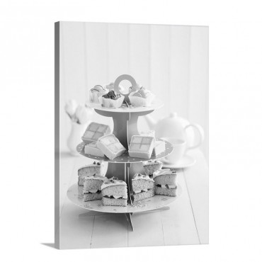 A Tiered Cake Stand With Petit Fours Battenburg Cake And Victoria Sponge Cake Wall Art - Canvas - Gallery Wrap