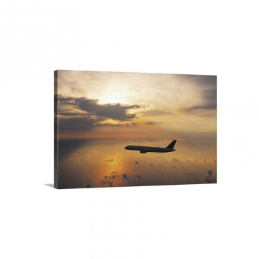 Commercial Aeroplane Flying Above The Sea At Dusk Wall Art - Canvas - Gallery Wrap