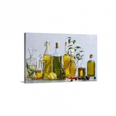 Various Types Of Olive Oils In Bottles With Herbs Lemon And Olives Wall Art - Canvas - Gallery Wrap